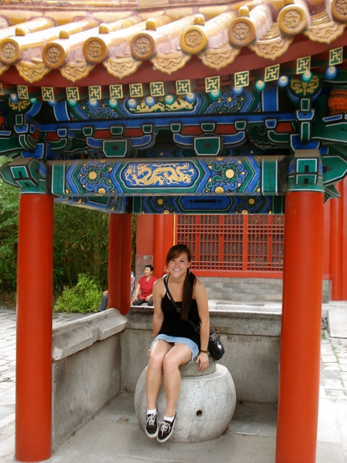 Study Abroad student sitting in ornate temple gazebo