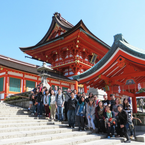 Study abroad students posing for a picture outside the Kiyomizu-dera Temple