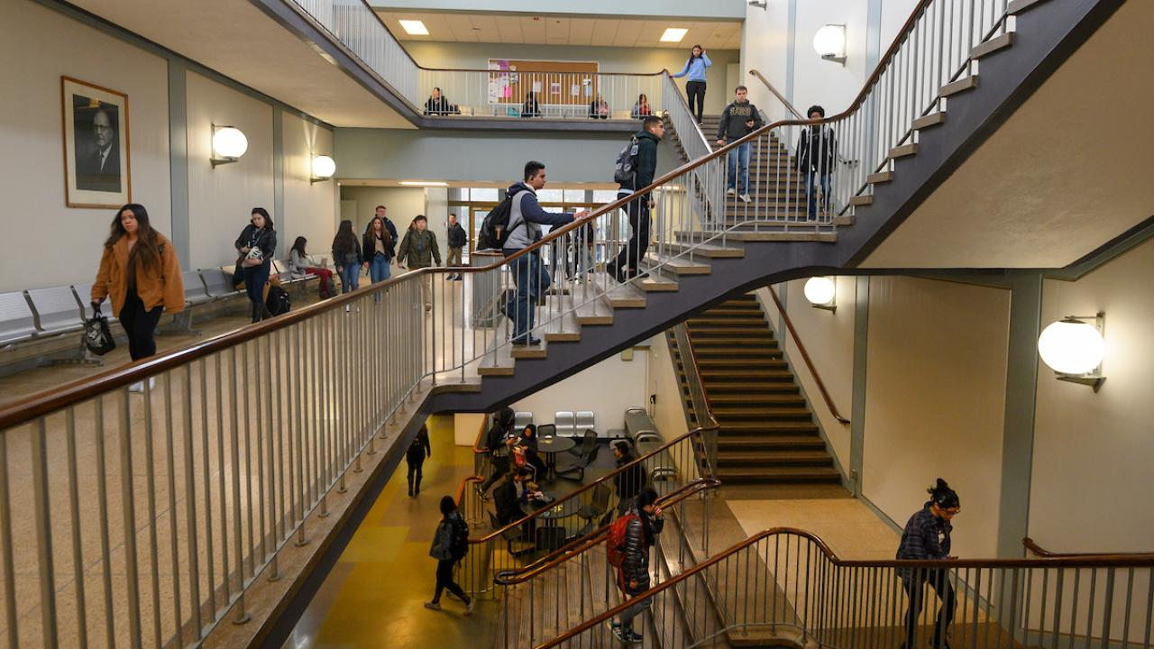 Students walking in hallways and stairwells.