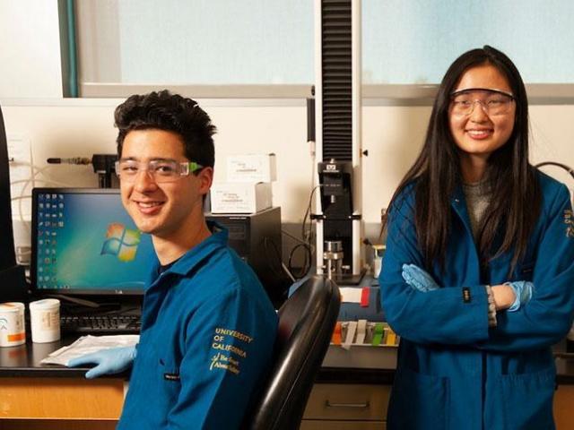 male and female student in lab gear